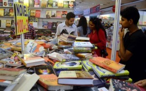 Visitors having a close look at the books available at the 21st Delhi Book Fair at Pragati Maidan, in New Delhi in August, 2015. Photo: Sushil Kumar Verma ( The Hindu)